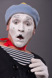 Portrait of young male mime with white face, grey Royalty Free Stock Images