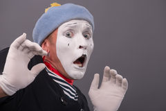 Portrait of young male mime with white face, grey Stock Photography