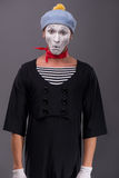 Portrait of young male mime with white face, grey Royalty Free Stock Photos