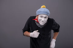 Portrait of young male mime with white face, grey Royalty Free Stock Image