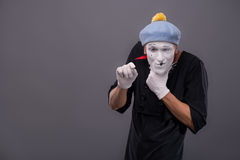 Portrait of young male mime with white face, grey Royalty Free Stock Photography