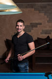 Portrait Of A Young Male Model Playing Billiards Stock Photos
