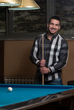 Portrait Of A Young Male Model Playing Billiards Royalty Free Stock Photo