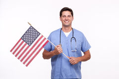 Portrait of a young male nurse Holding American flag Stock Photo