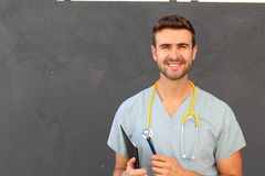 Portrait of young male nurse in scrubs smiling.  Stock Photo