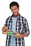 Portrait of a young male painter with palette Stock Image