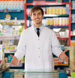 Portrait of young male pharmacists. Working in modern farmacy Royalty Free Stock Image