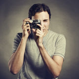 Portrait of young male photographer with a camera Stock Photo