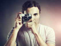 Portrait of young male photographer with a camera Stock Photos