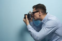 Young male photographer holding a new camera stock photos