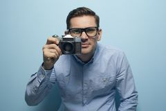 Young male photographer holding a new camera royalty free stock photo