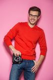 Portrait of young male with professional digital camera. Royalty Free Stock Images