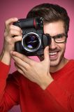 Portrait of young male with professional digital camera. Stock Photo