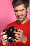 Portrait of young male with professional digital camera. Royalty Free Stock Photo