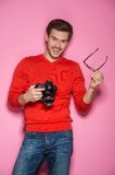 Portrait of young male with professional digital camera. Royalty Free Stock Photos