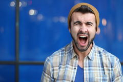 Portrait of a young male screaming.  Stock Photography