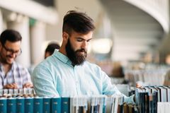 Portrait of young male student in library. Portrait of young male student in university library Stock Images