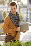 Portrait of young male student outdoors. Portrait of male student holding books outdoors Royalty Free Stock Images