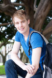 Portrait of a young male student in a park Royalty Free Stock Photo