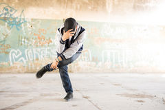 Portrait of a young male urban dancer. Full length view of a young male urban dancer performing a dance routine in an abandoned building. Plenty of copy space Stock Photography
