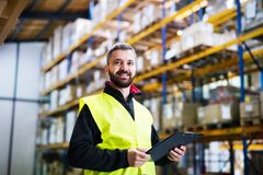 Male warehouse worker with clipboard. Portrait of a young male warehouse worker with clipboard Stock Photography