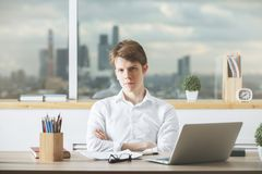 Portrait of young male at workplace Stock Photo