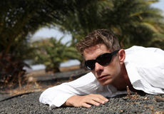Portrait of young man. Under palm Royalty Free Stock Photos