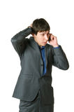 Portrait of the young man. The young man costs speaks by phone stock photography