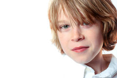 Portrait of a young man. High key image of an adolescent boy Stock Photos