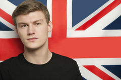 Portrait of young man against British flag Royalty Free Stock Photos