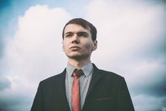 Portrait of Young Man Against Sky stock photos