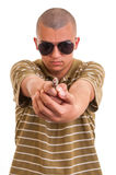 Portrait of young man aiming toy gun at you Royalty Free Stock Photos