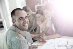Portrait of a young man amongst a group of students working Royalty Free Stock Photos