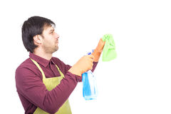 Portrait of young man with apron and gloves cleaning Royalty Free Stock Image