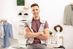 Portrait of young man in atelier. Small business owner royalty free stock photos