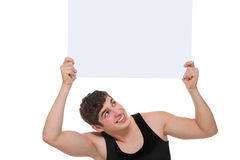 Portrait young man. Athlete holding  blank  ad Royalty Free Stock Image