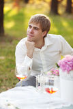 Portrait of young man in the autumn park Royalty Free Stock Photos