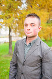Portrait of young man in autumn park Stock Photography