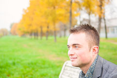 Portrait of young man in autumn park Royalty Free Stock Image