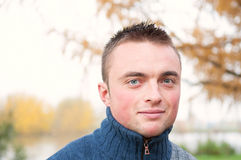 Portrait of young man in autumn park Stock Photos