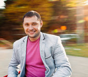 Portrait of young man in autumn park Royalty Free Stock Photo