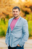 Portrait of young man in autumn park Royalty Free Stock Images