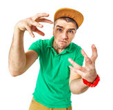 Portrait of young man b-boying in studio isolated on white. Royalty Free Stock Image