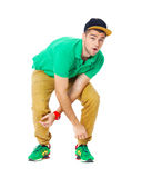 Portrait of young man b-boying in studio isolated on white. Stock Photo