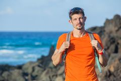 Portrait young man with backpack Stock Photos