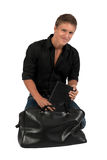 Portrait of young man with bag. Royalty Free Stock Images