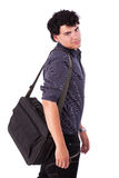 Portrait of a young man with a bag Stock Photo