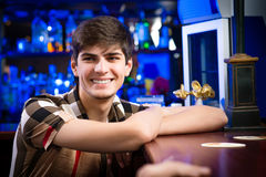 Portrait of a young man at the bar Stock Photo