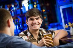 Portrait of a young man at the bar Stock Image