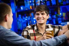 Portrait of a young man at the bar Royalty Free Stock Image